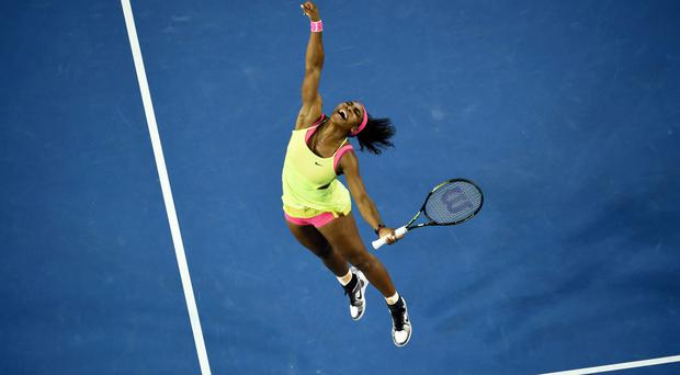 Serena Williams celebrates after victory in her women's singles final match against Maria Sharapova on day thirteen of the 2015 Australian Open