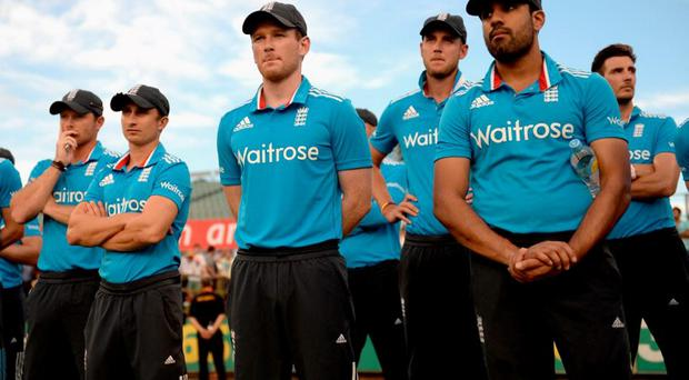 England captain Eoin Morgan and his team watch the presentations after losing the final match of the Carlton Mid One Day International series between Australia and England