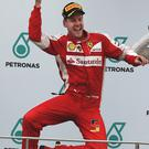 Sebastian Vettel celebrates on the podium after winning the Malaysian Grand Prix in Sepang yesterday
