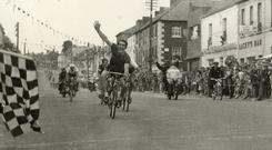 Christy Kimmage, who died on Monday, celebrates winning the penultimate stage of the Rás in Gorey, in 1963. He also won the final stage into Dublin the following day