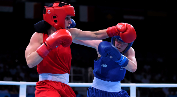 Ceire Smith, Ireland, right, exchanges punches with Camilla Johansen, Norway,