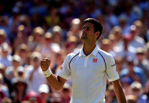 Djokovic punches the air as he puts away the final game to love with a magnificent flourish of serving