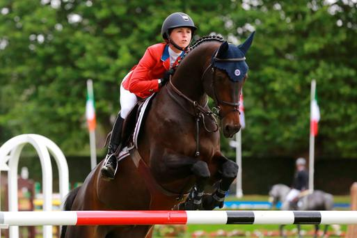 Georgina Bloomberg on Caleno 3 clears the fence during the Irish Sports Council Classic
