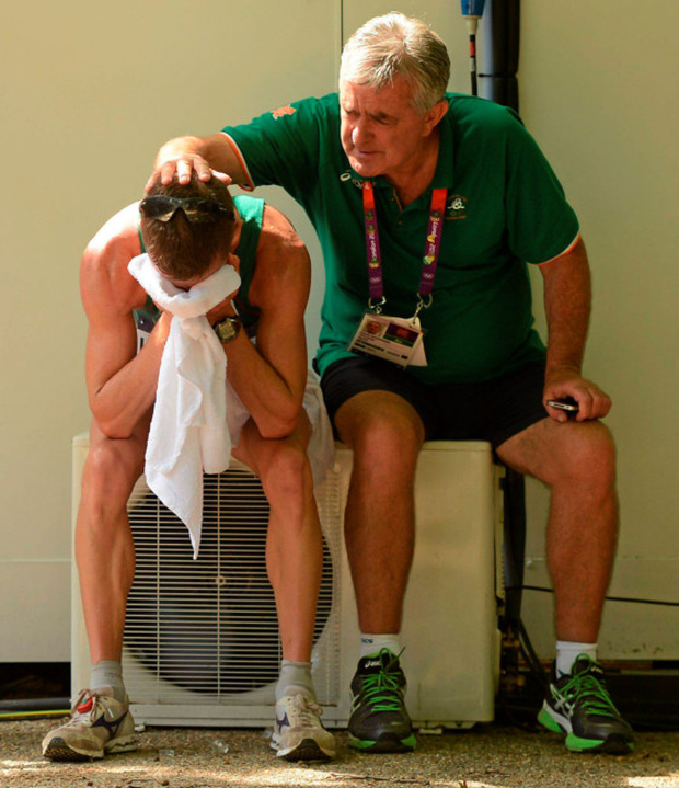 Rob Heffernan with team manager Patsy McGonigle after finishing fourth during the 50km walk at London 2012