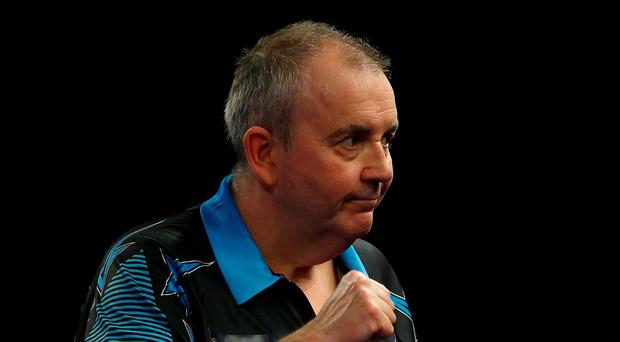 Phil Taylor celebrates winning his 1st round match during day three of the William Hill PDC World Championship Photo:PA