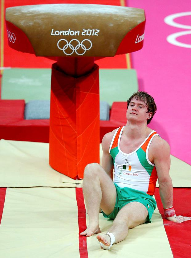 Struggle: Kieran Behan reacts after falling from the vault at the men's gymnastics qualification during the London 2012 Olympic Games.