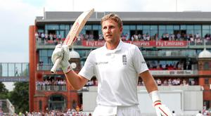 Joe Root leaves the field at Old Trafford after scoring 254 runs in the second Test. Photo: PA