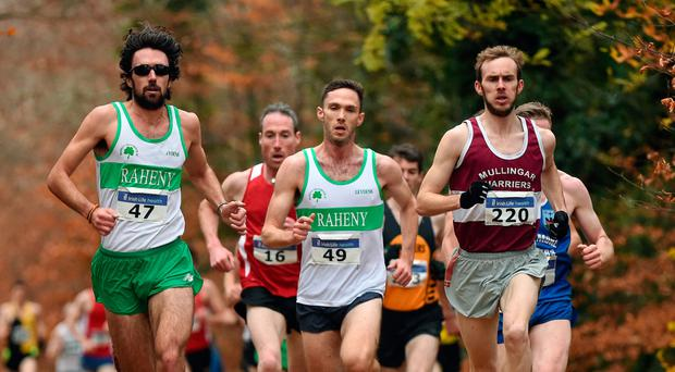 Eventual winner Mark Christie, right, from Mullingar Harriers, runs alongside three-time reigning winner Mick Clohisey, left, from Raheny. Photo: Sportsfile