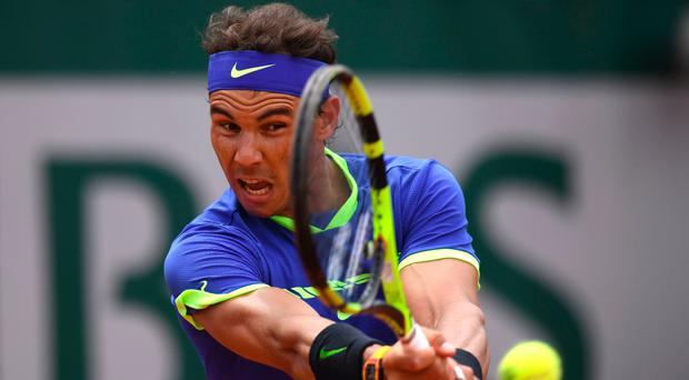 Rafa Nadal returns a ball during his fourth round match yesterday with his compatriot Roberto Bautista Agut. Photo: Getty