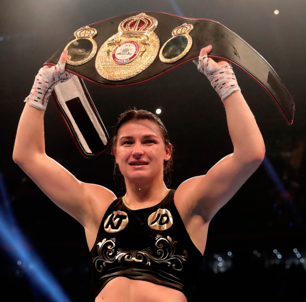 Katie Taylor celebrates with the WBA World Female Lightweight belt after her win last night. Photo: PA