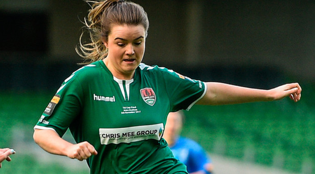 Claire Shine of Cork City WFC is tackled by Claire Walsh of UCD Waves. Photo: Sportsfile