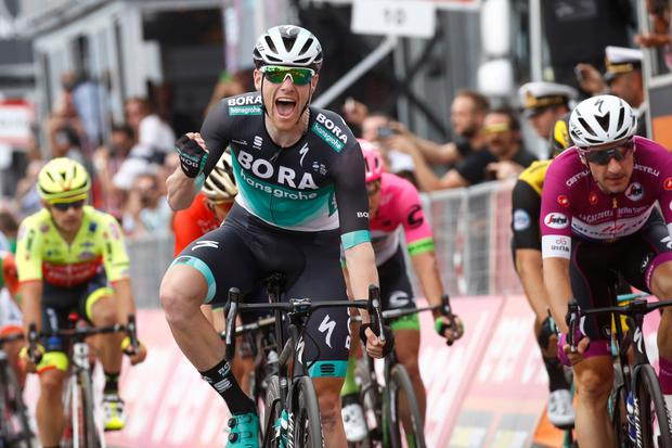 Sam Bennett celebrates his victory on stage seven of the Giro d'Italia in Praia a Mare yesterday Photo: Getty Images