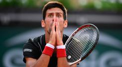 Novak Djokovic reacts after missing a shot against Marco Cecchinato during his French Open quarter-final defeat. Photo: AFP/Getty