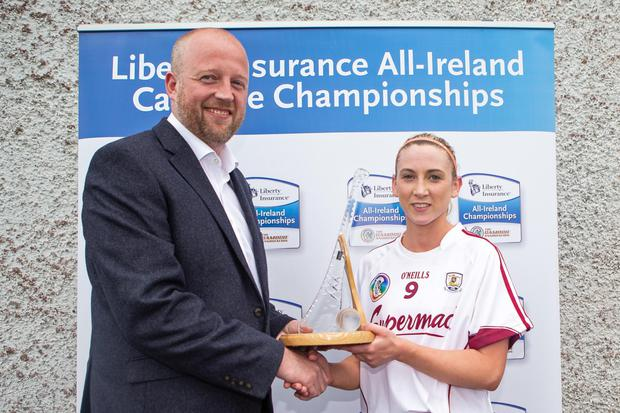 The Liberty Insurance Player of the Match Award for the Galway v Clare is presented to Niamh Kilkenny of Galway by John Coffey, the head of communications at Liberty Insurance