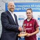 Galway's Carrie Dolan, who scored 1-8, is presented with the player of the match award by John Coffey, Head of Communications at Liberty Insurance