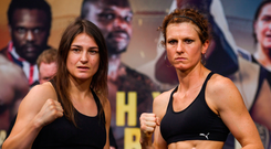Katie Taylor and Kimberly Connor at the weigh-in yesterday ahead of their WBA & IBF World Lightweight Championship bout in London tonight Photo: Sportsfile