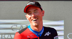 BMC Racing Team's Australian cyclist Rohan Dennis celebrates after winning the 16th stage of the Vuelta a Espana. Photo: AFP/Getty