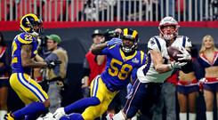 Patriots tight end Rob Gronkowski catches a pass ahead of Rams' Cory Littleton (58) during Super Bowl LIII in Atlanta on Sunday night. Photo: Matthew Emmons-USA TODAY Sports