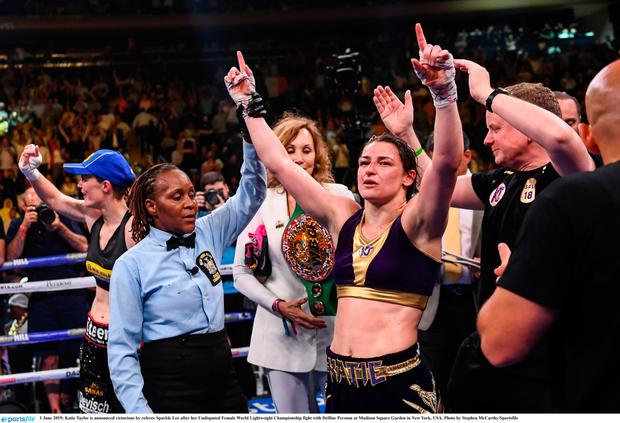 Katie Taylor is announced victorious by referee Sparkle Lee after her Undisputed Female World Lightweight Championship fight with Delfine Persoon at Madison Square Garden in New York, USA. Photo by Stephen McCarthy/Sportsfile