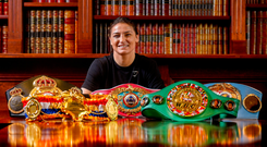 Katie Taylor poses with her belts in Dunshaughlin, Co Meath after returning home from New York as the undisputed World Lightweight Champion. Photo: Sportsfile