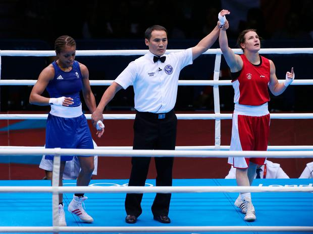 Ireland's Katie Taylor (right) celebrates her victory over Great Britain's Natasha Jonas at the London 2012 Olympics. Jonas has waited nine years for a chance at revenge over Taylor, but the pair are in agreement that their memorable fight at the Olympics will have little bearing on this weekend's showdown. Photo credit: Nick Potts/PA Wire.
