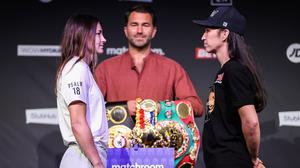 Katie Taylor (left) at the weigh in for her fight against Jennifer Han. Image credit: Sportsfile.