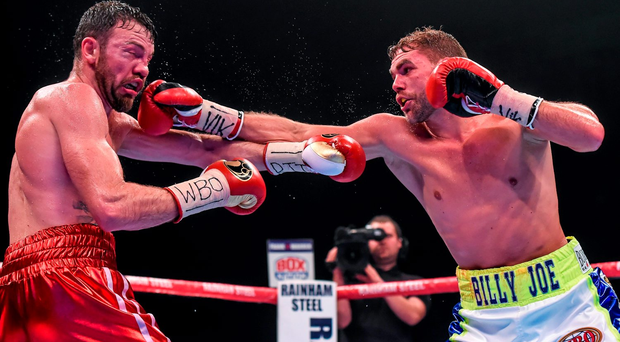 Andy Lee is caught by the right hand of Billy Joe Saunders during Saturday night's WBO World middleweight title fight Photo:Sportsfile
