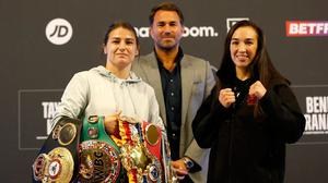 Katie Taylor poses with Jennifer Han and promoter Eddie Hearn with her belts after the press conference at the Queens Hotel, New Station Street, Leeds yesterday. Photo: Action Images via Reuters