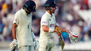 England's Haseeb Hameed (left) and Rory Burns walk off the pitch at the end of the days play on day four of the cinch Fourth Test at the Kia Oval, London. Credit: PA