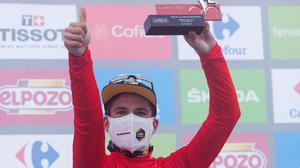 Primoz Roglic of Slovenia wears the red-shirt of La Vuelta leader on the podium at the end the 18th stage. (AP Photo/Lalo R. Villar)