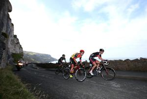 Riders make their way around Great Ormes Head to the finish line during stage two of the Tour of Britain in Llandudno, Wales