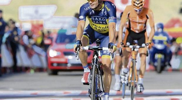 Nicolas Roche crosses the line in 22nd place after the 146km stage from Graus to Aramon Formigal