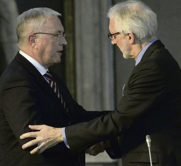 New UCI president Brian Cookson (right) offers his commiserations to Pat McQuaid after he defeated him in the recent election