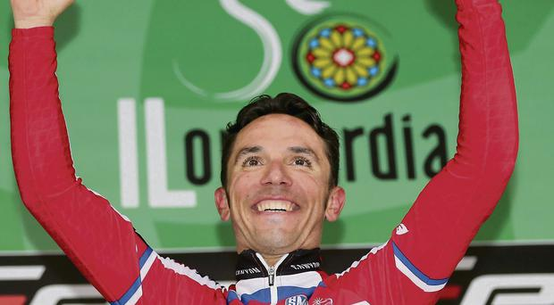 Joaquin Rodriguez celebrates on the podium after winning the Tour of Lombardy yesterday. The Spaniard bounced back from a stinging defeat in last weekend's World Championships to successfully defend his title