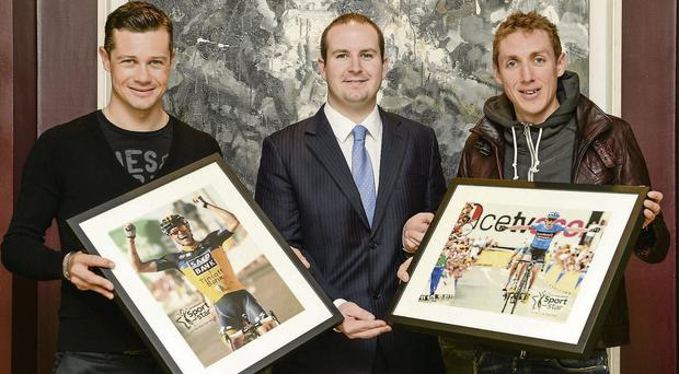 Nicolas Roche, left, was presented with an Irish Independent Sportstar of the Week Awards by Alan Smullen, General Manager of The Croke Park Hotel yesterday in Dublin BRENDAN MORAN / SPORTSFILE