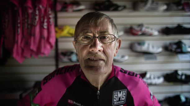 'We step out to the Newtownards Road where the Giro d'Italia will pass not once, but twice next Friday evening. It won't matter to most of the riders. They won't notice the wiry ex-champion with his champion sons and his champion daughter, camped in front of the bike shop. But it matters to them.'