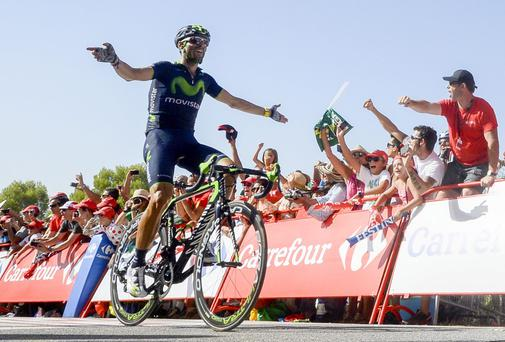 Spanish cyclist Alejandro Valverde of Movistar celebrates as he crosses the finish line to win the 6th stage of the 69th edition of 'La Vuelta' Tour of Spain