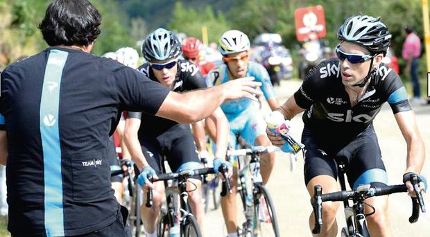 Philip Deignan takes on some energy supplies during yesterday's stage of the Vuelta