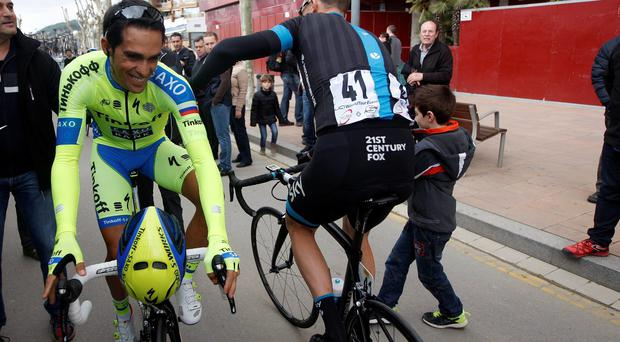 Chris Froome greets Alberto Contador before the start of Stage 1 of the Volta a Catalunya