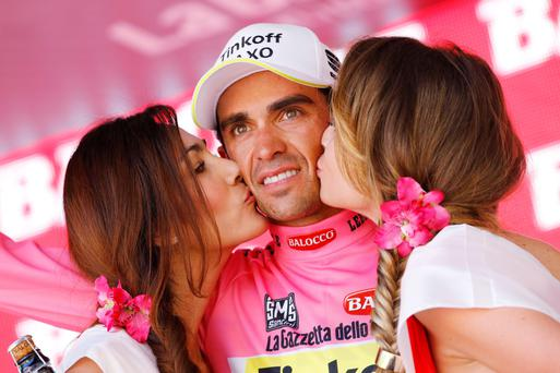 Alberto Contador is congratulated after retaining the Pink Jersey yesterday
