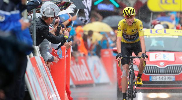 Chris Froome finishes yesterday's 20th stage of the Tour de France in heavy rain stage twenty of the 2016 Le Tour de France. Photo: Chris Graythen/Getty Images