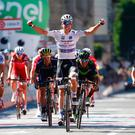 Luxembourg's Bob Jungels celebrates as he crosses the finish line to win the 15th stage of the 100th Giro d'Italia. Photo: Luk Benies/AFP/Getty Images