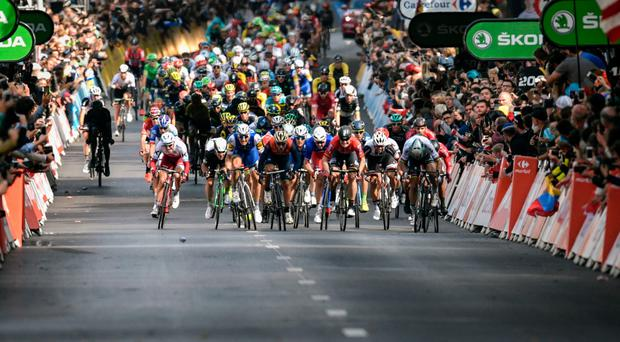 The peloton wind up for the sprint finish into Liege yesterday. Photo: Jeff Pachoud/AFP/Getty Images