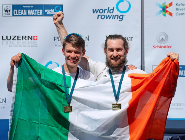 Ireland's Fintan McCarthy and Paul O'Donovan celebrate with their gold medals after victory in the Lightweight Men's Double Sculls Final A at the 2021 World Rowing World Cup II in Lucerne, Switzerland. Photo: Roberto Bregani/Sportsfile