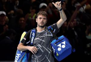 Stanislas Wawrinka of Switzerland reacts after losing his semi-final tennis match against compatriot Roger Federer