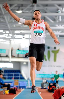 Adam McMullen, Crusaders AC, on his way to winning the Men's Long Jump Event and setting a European Standard qualifying distance during Day 2 of the GloHealth Senior Indoor Championships