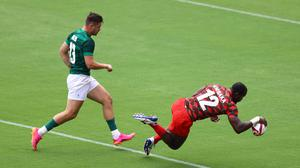 Willy Ambaka of Kenya scores a try against Ireland in the Olympics rugby sevens. REUTERS/Siphiwe Sibeko