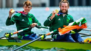Fintan McCarthy and Paul O'Donovan celebrate with their gold medals after winning the Men's Lightweight Double Sculls final in Tokyo. Photo: Seb Daly/Sportsfile