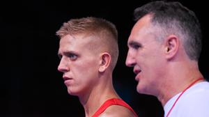 Kurt Walker is accompanied by coach Billy Walsh to the ring during the 2015 European Games. Photo: Sportsfile
