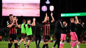 Keith Ward of Bohemians, centre, applauds fans